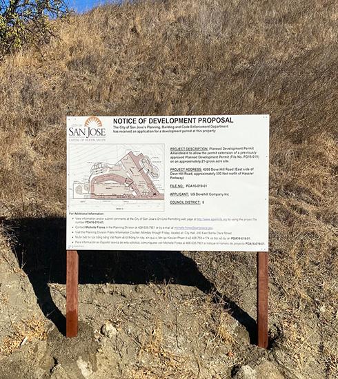 development-proposal-sign